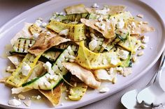 Bread crisps, creamy feta, pint-sized pine nuts and refreshing mint blend beautifully with soft skinny strips of green and gold zucchini.