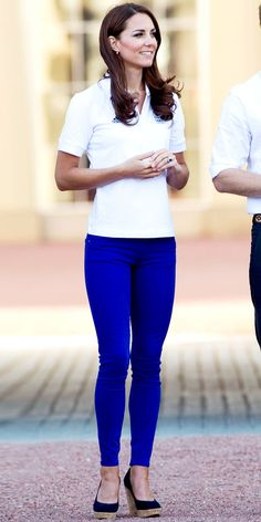 Catherine Middleton WHAT SHE WORE Middleton brightened up the Olympic torch relay in a white polo, cobalt jeans and suede wedges.