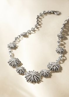 Starburst necklace in sterling silver with diamonds.