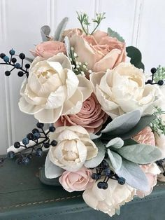 Blush and ivory peony and rose wedding bouquet, Sola wood flowers, eco flowers ***12 bouquet READY TO SHIP** All other sizes are maade to order. Unique wedding bouquet full of natural sola wood flowers. The wooden flowers are hand dyed in shades of pale blush pinks. Navy blue berries,