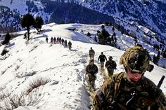 Observation point hike: Afghan Border Police and U.S. Army Soldiers from ABP Zone 1, 1st Brigade Combat Team, 101st Airborne Division, hike from their landing zone to an observation point along the Afghanistan-Pakistan border, Jan. 21, 2013. U.S. Army Photo by Sgt. Jon Heinrich, CT 1-101 Public Affairs   The U.S. Army, via Flickr