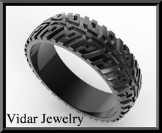 Black Gold Tire Tread Men's Wedding Ring  Let your women drive you safely with this Men's Tire Tread Wedding Ring!  Metal/weight/detail: 14K black gold-black rhodium on 14K Gold,About 7-8Gr  width: 7mm  Thick:1.5mm  $1175