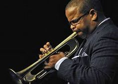 Terrance Blanchard. Just saw him live at Jazz Standard. Built in mouth piece. MMM trumpet.