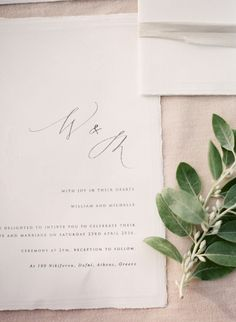 minimal wedding invitation with calligraphy initials