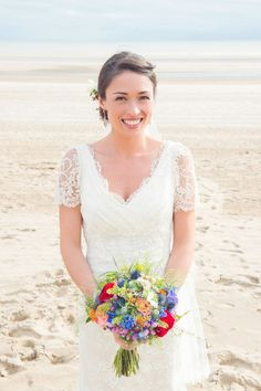 """""""My bouquet was made with 'Miss Piggy' roses, blue delphiniums, nigella and thistles, and finished with twine."""""""