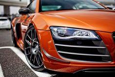 Audi R8 in burnt orange.