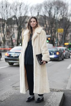 A long faux fur coat for a touch of drama.