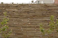 awesome stacked reclaimed wood wall