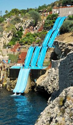 Located on the northwest coast of Sicily, Italy, on the Gulf of Castellammare, the hotel Città del Mare boasts one of the most spectacular water slides ever built. The slide, constructed on a cliff, has three separate pools of water, the Mediterranian being the final splash. #Waterslides #Sicily