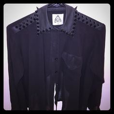 "UNIF ""Caution"" Shirt (Black). Size: ""XS"" UNIF ""Caution"" shirt. Size:XS (fits like a ""S""). Shoulders & collar are studded. Material is 100% polyester/the entire shirt is sheer! The sleeves can be buttoned or cuffed. I love the back of this shirt! So unique! Also, I've only worn this shirt twice but somehow managed to put a very small hole near the collar. The black paint has also slightly worn off the tips of the studs (These imperfections you can see in the last picture). Still in great…"