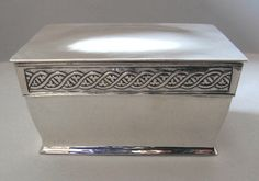 BIRMINGHAM GUILD OF HANDICRAFTS Ltd. - A silver box with entwined 'Celtic frieze'. Engraved with a presentation inscription of historical interest 'Robert Catterson Smith from William Kenrick. Nov. 1914'. Marked for B'ham Guild of Handicraft. Hallmarks