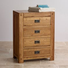 The Quercus Rustic Solid Oak Tall 4-Drawer Dresser is a must-have for your bedroom, providing valuable extra storage space.
