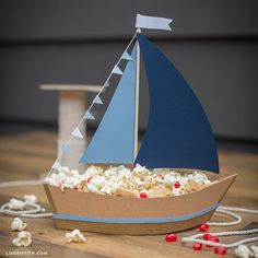 Ship Party Snacks with This DIY Paper Sailboat Centerpiece!- Ship Party Snacks with This DIY Paper Sailboat Centerpiece! Need a nautical centerpiece for your kid& party? We& come up with an amazing, easy-breezy paper sailboat snack holder project. Nautical Centerpiece, Diy Centerpieces, Cardboard Crafts, Paper Crafts, Cardboard Furniture, Diy For Kids, Crafts For Kids, Boat Crafts, Ostern Party