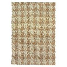 An inspired take on British country styles, this richly textured jute rug boasts an oversized houndstooth motif.  Product: RugConstruction Material: JuteColor: Bleach and naturalNote: Please be aware that actual colors may vary from those shown on your screen. Accent rugs may also not show the entire pattern that the corresponding area rugs have.Cleaning and Care: Vacuum regularly to prevent dust and crumbs from settling into roots of the fibers