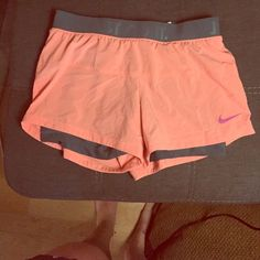 Nike training shorts. Loose fit with spandex Nike Training shorts - peach/orange. Worn once. Loose fit with nike pro style spandex built in. Nike Shorts