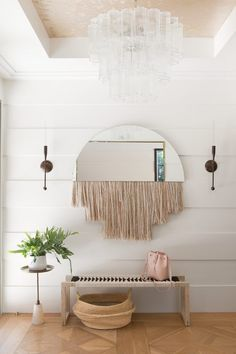 fringe mirror in the entryway