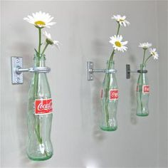 3 CocaCola Bottle Hanging Flower Vases. With Gerry in mind, maybe Dr Pepper :-)