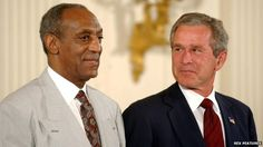 Cosby is awarded the Presidential Medal of Freedom by George W Bush in 2002