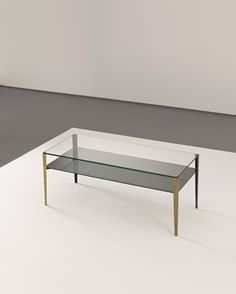 GIO PONTI Coffee table, model no. 2341, circa 1962  Glass, opaque glass, brass, painted metal. 40 x 105 x 42 cm (15 3/4 x 41 3/8 x 16 1/2 in) Manufactured by Fontana Arte, Milan, Italy. Together with a certificate of authenticity of the Ponti Archives