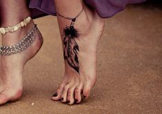 Foot feather tattoo