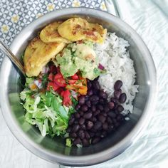 Mmmm salad today  Romaine, rice, black beans, fresh pico, guac, and plantains