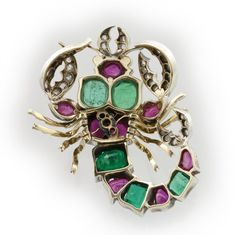 A Victorian ruby, emerald and diamond scorpian brooch
