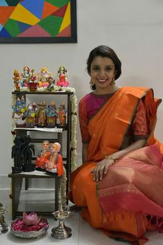 This lovely lady came visiting my navratri kolu in a stunning orange kancheepuram saree.. and I was so glad I hosted her.. love you. I love the pallu and the way she has matched the blouse. So chic