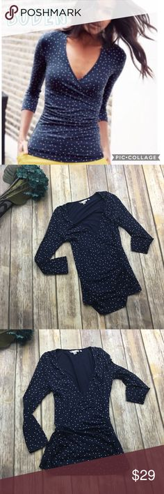 🎈 Boden Navy Blue Polka Dot Wrap Top Navy blue polka dot wrap 3/4 sleeve top. Size 6. In excellent used condition. 95% viscose 5% elastase. 25 inches long. 17 inches arm pit to arm pit without stretching material laying flat. Boden Tops Blouses
