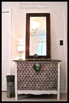 Small Moorish Fleur de Lis stenciled on wood dresser.