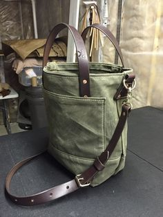 Check out this waxed canvas bag. By BattleAx Leathers.