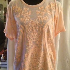 Peach tshirt with a BEAUTIFUL design Sz Large Perfect for summer, this peach colored tshirt is light as air. Feels like you're wearing nothing. Breathable. To top it off, the design on it is stunning. Size is large. Wear with your favorite shorts or jeans. XX1 Tops Tees - Short Sleeve