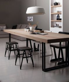 - A large wooden table for either a study desk or kitchen table. I love the combination of reclaimed wood against black iron or bands. #LampEettafel