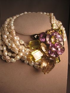Iradj Moini necklace - 12 strands of fresh water pearls with large amethyst citrine flower pin that can be removed