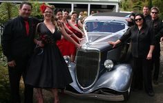 this is the kind of car i had in mind! (idk of you have access to one lol) im thinking it would be cute to have you sitting on the hood and the bridal party fanned out behind you both!