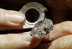 Britain Diamonds. A 14.79 carat Diamond ring by Harry Winston.