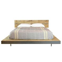 This is a really beautiful bed! Available in any size - size shown is queen. It is made out of Recycled steel and wood reclaimed from old US