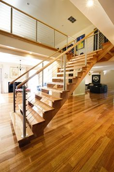 Modern | Victorian Ash | Stained | Cut Stringers | Open Stair | Wire Balustrade | Timber Handrail | Stainless Steel Posts