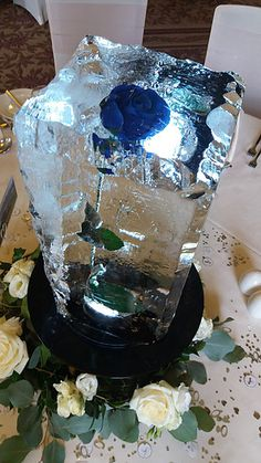 Wedding Ice sculpture table centres, ice champagne bucket, ice statues, ice carvings, ice luges for all UK events corporate and hospitality. Call 08009996555