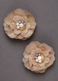 Add a fun flare to your hair style with these adorable cluster flower clips  Adorned with pearls and rhinestones at the center of each flower.  Available in Champagne. Set of 2.  Imported.