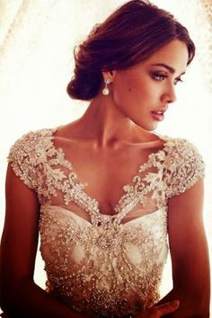 Gorgeous white bridal dress. I think the lace is gorgeous!