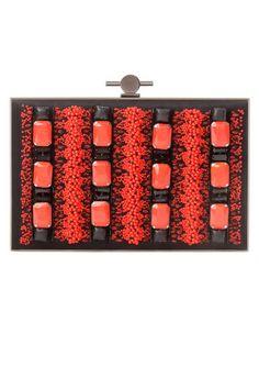 *.* The Jeweled-Box Clutch Jason Wu Beaded Brass Clutch, $2,495; fivestory.com