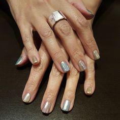 Chrome powder on top of pastel gel polish colours.