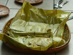 Tamales with pork and amarillo (yellow) mole in Oaxaca