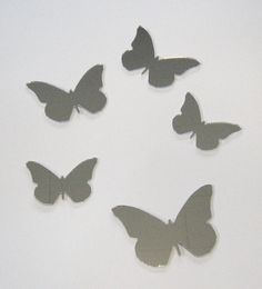 FREE SHIPPING  A set of 5 acrylic butterfly mirrors of varying sizes:   1 @100mm high  2 @ 85mm high  2 @ 70mm high   Mirrors come with protective paper on the front. They can be held up with blu-tack, double sided tape, or a non solvent based adhesive.  FREE SHIPPING!  Shipping is inc...