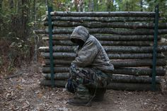 """FLOVILLA, UNITED STATES - NOVEMBER 12: A member of the Georgia Security Forces (GSF) is seen during military drill with group members of III% Georgia Security Force in Flovilla, Georgia, USA on November 12, 2016. The militia calls itself the Georgia Security Forces (GSF), they are white supremacists on the look for foreign threats either it's the Russians or ISIS as they claim. The group is a part of a wider unlinked phenomena called """"The Three Percenters (III%)"""" who are scattered across…"""