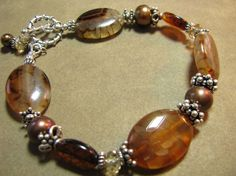 GENUINE Amber Brown Fire Agate, Coppery Freshwater Pearl, .925 Bali and Sterling Silver Bracelet via Etsy