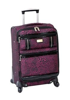 13 Non-Boring Carry-On Suitcase Designs: NICOLE MILLER Aninal Instinct Carry On Spinner Another one for animal print lovers, this one has some patent leather details and a deep magenta for a rocker vibe.