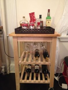 Just when you thought we were done making crafty things for our apartment, we are back at it with an awesome bar cart complete with a nifty stemware rack! No matter now many creative ideas we come … Small Apartment Kitchen, Ikea Kitchen, Kitchen Decor, Attic Apartment, Kitchen Drawers, Best Kitchen Faucets, Kitchen Faucet Reviews, Ikea Bar Cart, Brass Bar Cart