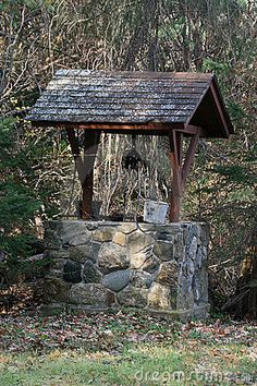 Wishing Well With Wooden Bucket And Rope Stock Photos - Image ...