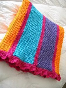 Happyghan  By: Glor for Crochet Galore           This bright and bold happyghan is made out of seven scarf sized strips. With such bright colors of Red Heart Super Saver on this free crochet pattern you can't help but smile and be happy. Wrap up in comfort with this crocheted afghan.